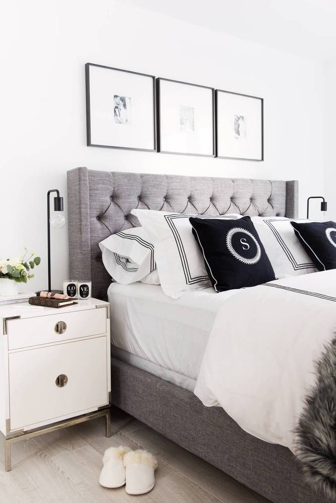 Master Bedroom Ideas with art hanging over a tufted gray bed. How to style your bedroom.