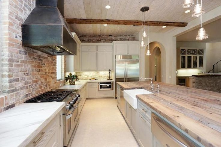 pale gray cabinets; raw steel hood; exposed brick backsplash; marble & reclaimed wood counters