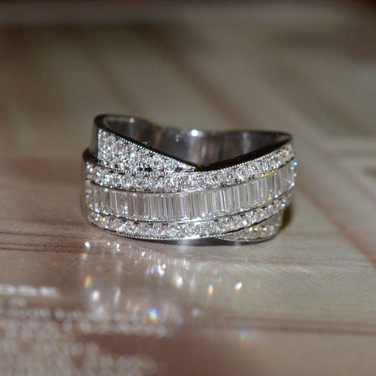 Round and Baguette Cut Diamond Wedding Band (18k White Gold). $2,500.00, via Etsy.
