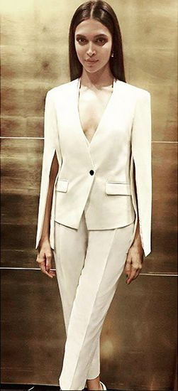 Deepika Padukone in a cream Rohit Gandhi + Rahul Khanna suit featuring unique slit sleeves.  Thx Vogue.in