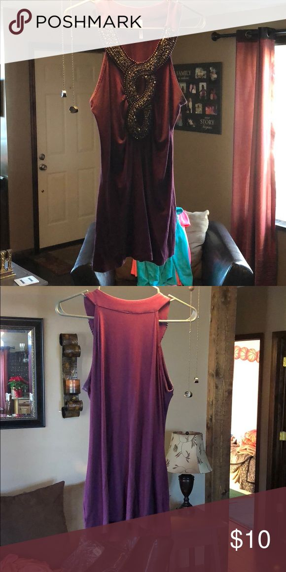 Maurices Dressy Tank Top Item comes from the women's clothing store Maurices. It has not been worn much. It is a dressy tank with a sequence design on the front. Size medium and the color is plum. Maurices Tops Tank Tops