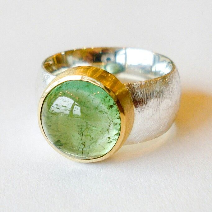 Silver and 22 karat gold ring with a stunning green tourmaline. www.heleenhoogenboom.com