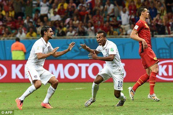 USA's goal against Belgium is scored by Jullian Green ( centre)