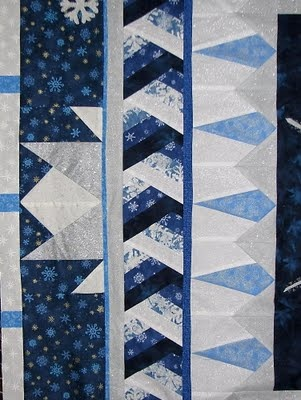 Sampaguita Quilts: Round Robin border details.  I love the braided look of the intertwined triangles.  Maybe i can figure this out ...