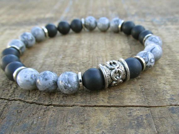 Gray jasper mens bracelet with matte black onyx beads and pewter accents. The jasper beads are 8mm with intricate patterns and nice variations of gray and black complemented by the matte gemstones making this a cool, hip bracelet for any guy. Wear this piece of mens jewelry alone or