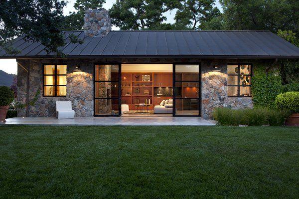 Fieldstone Guest Cottage, Sonoma, CA. Exterior Stone Façade, Metal Roof, Modern Steel Sliding Doors