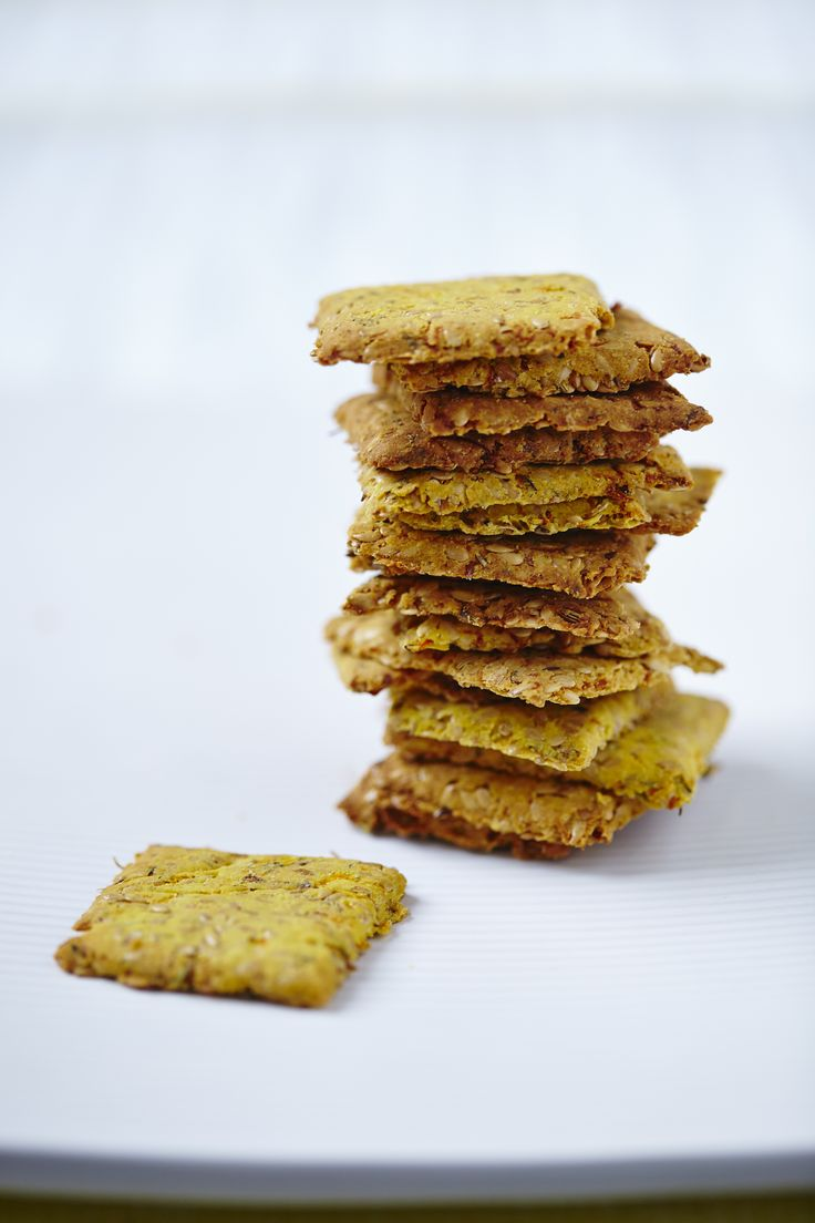 A stack of our delicious Carrot and Flax Crackers. Deciding what to dip them into...Find the recipe in The Art Of Eating Well.