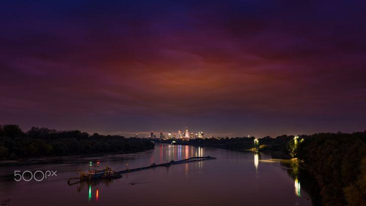 Cloud lcity lights - Warsaw from Siekierkowski Bridge at cloudy evening.