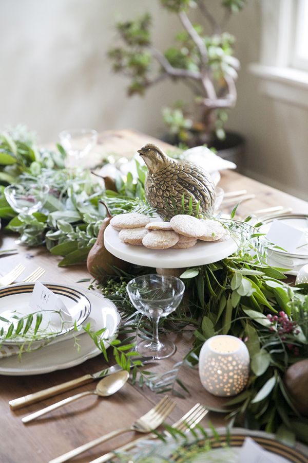 This year's Christmas tabletop features loads of greenery and simple settings inspired by the 12 Days of Christmas - including a partridge in a pear tree!