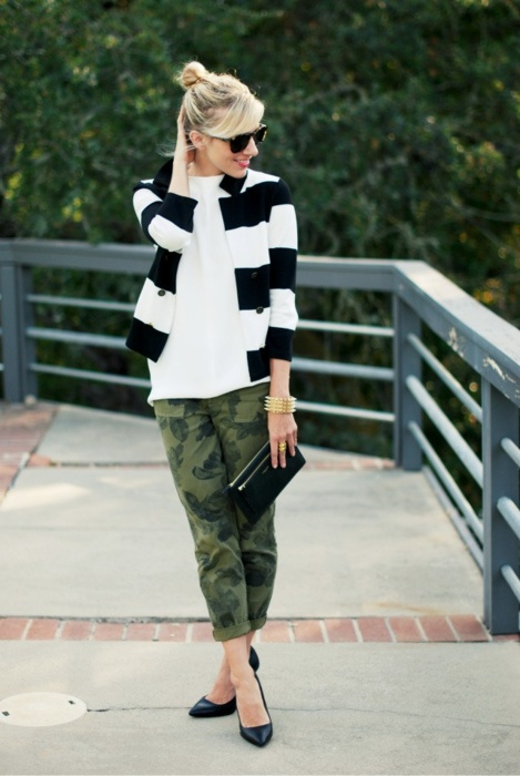 hmmm...striped cardigan with camoflauge pants,classic clutch and flats...would necklaces make this work better...jury's out for me on this one..did catch my attention though...