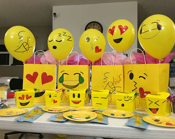 My husband and I made these emoji decorations for our daughters 10th birthday, yellow gift bags , yellow takeout boxes, small yellow plates , yellow balloons, used sharpies to draw on the faces