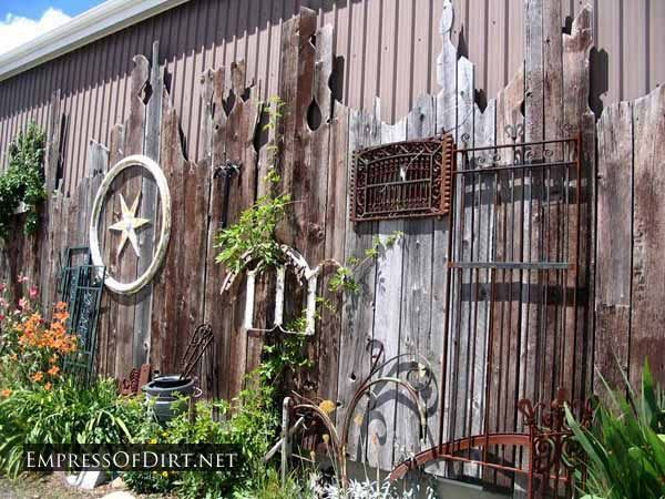 Wonderful display of eclectic garden art on a fence at a salvage yard. Use what you have to turn your fence into art!
