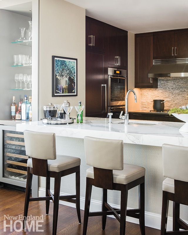 A Waterfall Peninsula Made Of Calcutta Is The Focal Point Of This Boston  Kitchen. Interior