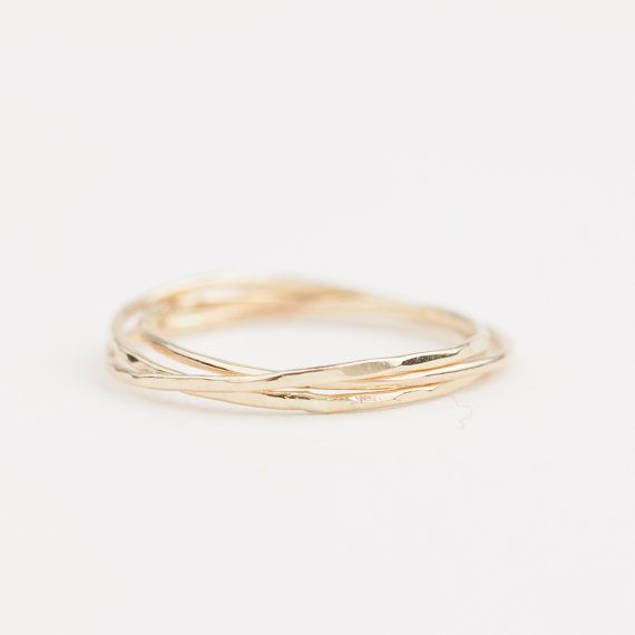 Gold streak trinity ring is made of intertwined 3 textured solid 14k gold rings…