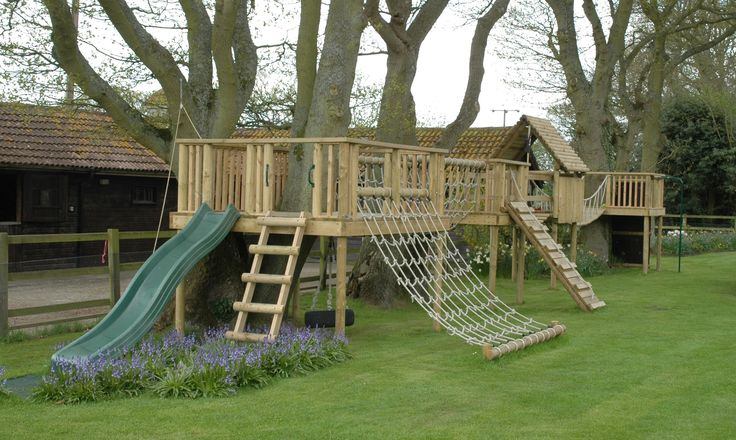diy outdoor fort with slide | Bespoke designed play structure built round trees