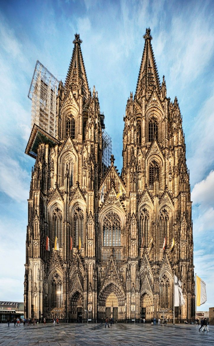 GOTHIC, Germany - Cologne cathedral, begun 1248. Its two huge spires give it the largest façade of any church in the world. The work at Cologen cathedral begun in 1248 by the architect Gerhard, at The Cologen cathedral is located at the same place where a Carolingian cathedral was, which was destructed by the fire in early 1248. It has been said that Ameins cathedral was the principal source of inspiration in the design of Cologen cathedral.