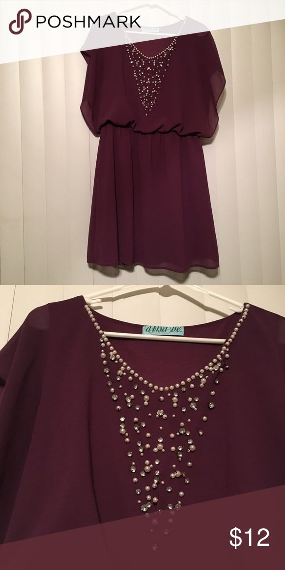 Wine colored dress; size large RePosh! Never worn since arrived. Wine colored dress with a sinched waist and a jeweled front. Dress is missing a few beads from top of neck which is hard to notice, but the first seller did not inform me when I purchased. Dress is from Francesca's and is a size large. Make an offer :) Francesca's Collections Dresses Mini