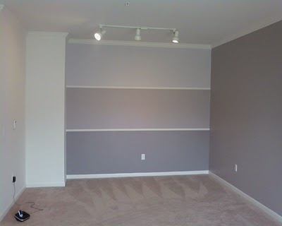 Make a new focal point wall using the exact colors on the paint cards. They will already match and will create an ombré effect. You can then use one of the colors in the rest of the room!  Very trendy without going overboard.