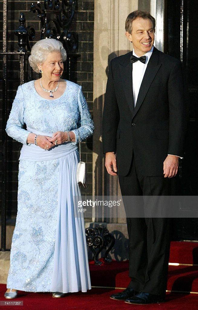 -- File picture dated 29 April 2002 shows Britain's Prime Minister Tony Blair Britain's welcoming Queen Elizabeth II at N? 10 Downing Street by in London. Blair announced 10 May 2007 his resignation after a decade in powerr, saying he will stand down at the end of June. He told party suporters in his constituency of Sedgefield that he would step down as Labour leader, and therefore as prime minister on June 27. AFP PHOTO/ADRIAN DENNIS