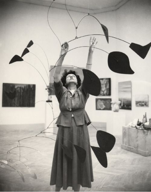 Peggy Guggenheim with an Alexander Calder mobile. Photo by Nino Migliori.