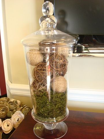 apothecary jar with natural balls and moss