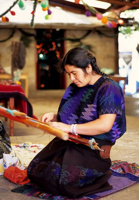 A woman weaves on her backstrap loom in Chiapas, Mexico.