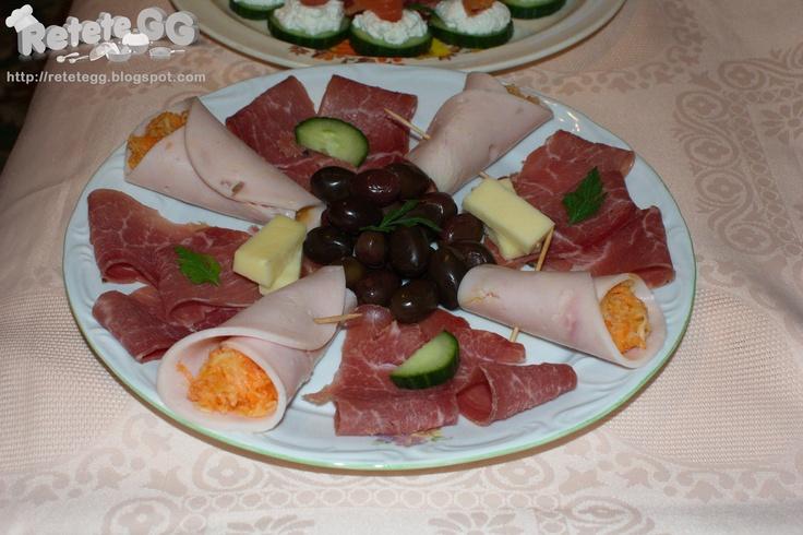 http://retetegg.blogspot.ro/2013/01/rulouri-de-sunca-cu-salata-de-cruditati.html