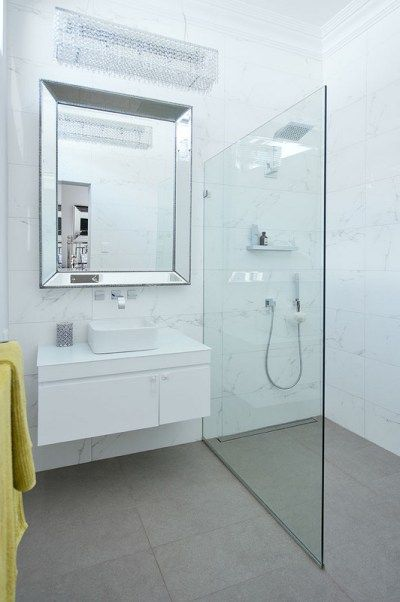 reno modern bathroom with marble tiles and modern grey and stainless steel fixtures