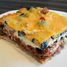 MEXICAN CASSEROLE - Changes: Use 2C crushed chips, not 3C.  Brown the ground beef with onion and add taco seasoning.