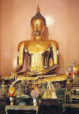 The Golden Buddha of Thailand, amazing: Solid Gold, 9.8 feet tall weighing 5.5 long tons originally housed in Ayutthaya, now in Bangkok.  At today's gold price of $1456 per troy oz: 179 666.667 troy oz of 18k gold, is worth an estimated 250 Million dollars, as a work of art, priceless.