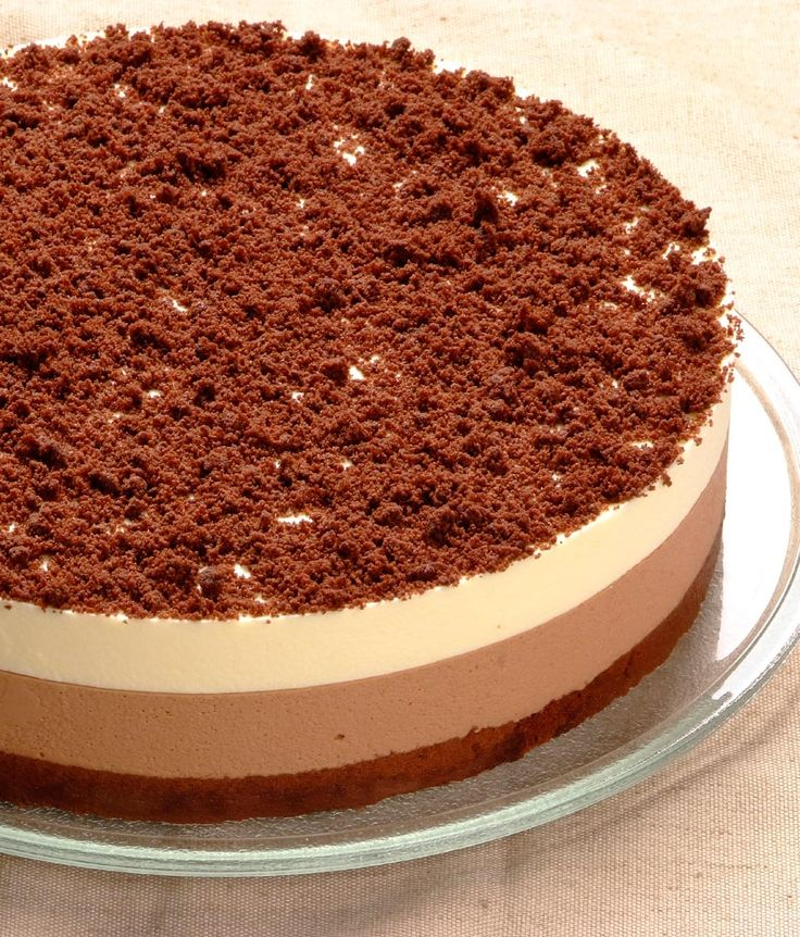 Two Tier Chocolate Mousse Cake: 1 x 24cm Layers of moist dark chocolate sponge, the creamiest white and dark chocolate mousse and a chocolate cookie crumble topping.