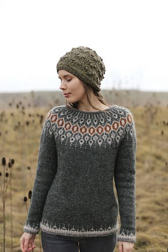 Inspired by traditional Icelandic circular yoke sweaters, Telja is knit in the round from the bottom up. Short rows are worked on the back of the sweater to bring the front of collar lower than the back. The stranded yoke is worked, and then the slightly scooped neckline is finished with an applied i-cord.