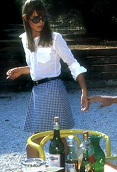 Jane Birkin - White button-up tucked into blue plaid wrap skirt with a black belt