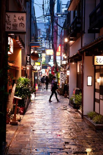 OSAKA. Hozenji Alley is a old narrow stone path behind Hozenji Temple. The path is lined with friendly traditional restaurants, shops and bars.
