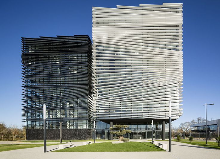 the façades include a set of sun blocker blades, laid out in such a way to create depth and transparency  as well as visually blur the different office levels.