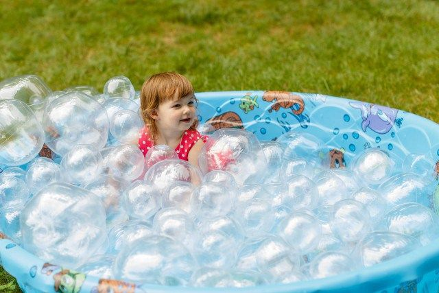 Bubble Ball Pit  Filled with bubbles that don't pop (clear beach balls), this ball pit had kids crawling in and out for a bucket load of fun.