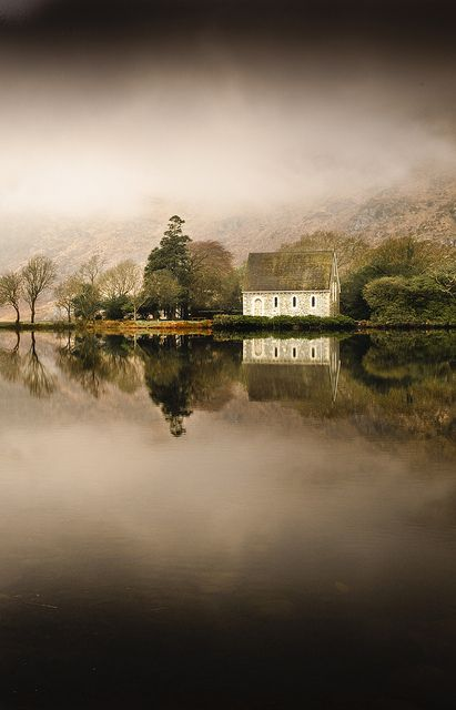 St. Finbarr's Oratory at Gougane Barra reflected against the still lake. Co. Cork, Ireland.