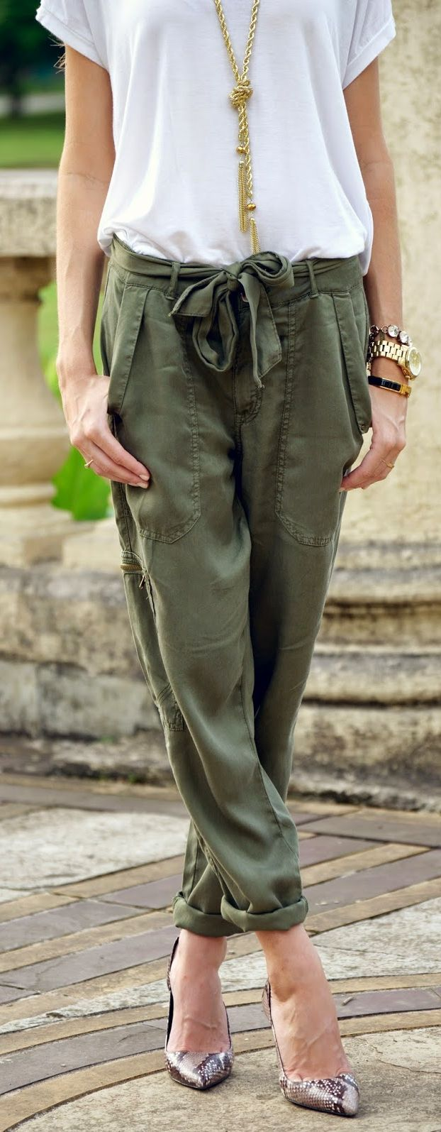 Olive cargo pants, white top, golden necklace, nude pumps