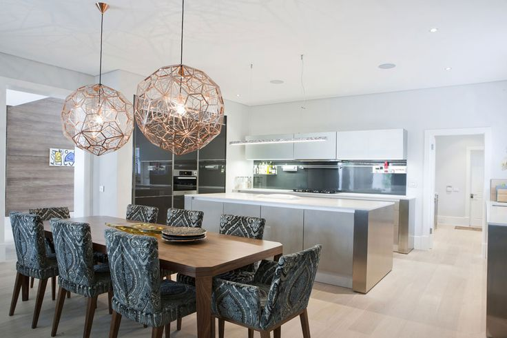 Open plan kitchen and dining room. We love the lights that have been included in the interior design to give that modern feel with the clean, stainless steel counter top finish in the kitchen.  Simple and elegant once again.