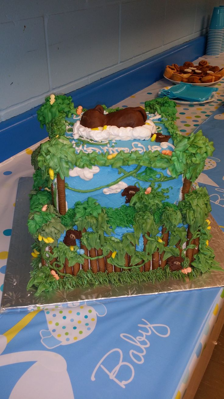 Jungle Monkey Baby shower cake - Chocolate baby with a monkey outfit on top
