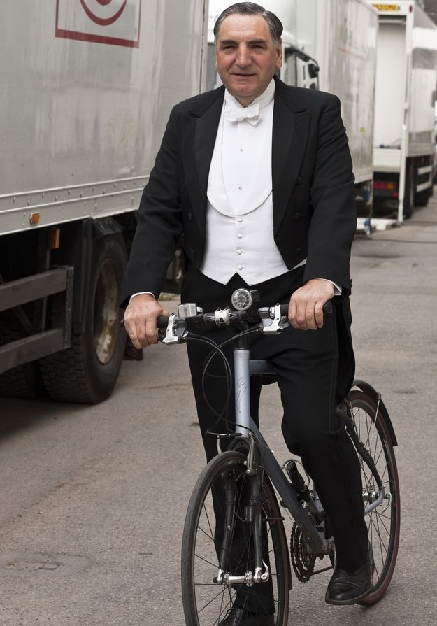 "Mr. Carson riding a speed bike… | 29 Photos Of The Cast Of ""Downton Abbey"" Being Totally Un-Downton-Like"