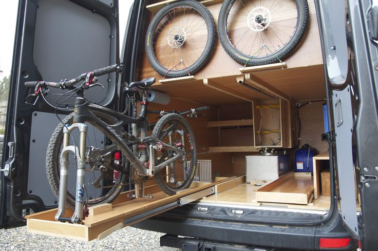 Sprinter DIY campervan by Allen Sutter, with beautiful pull-out rear bike drawers for the mountain bikes they carry.