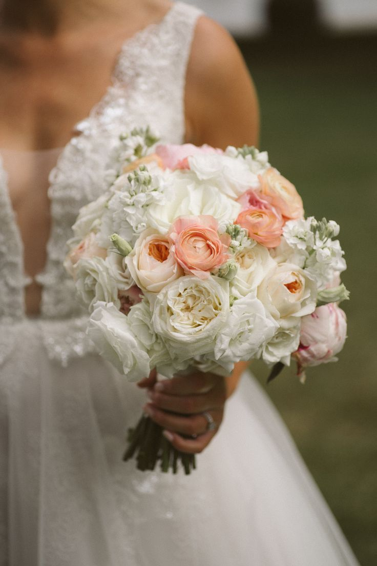 White and coral wedding bouquet; Ines di Santo Gown; PHOTOGRAPHY Joel + Justyna Bedford; FLORALS The Design Co Ottawa;
