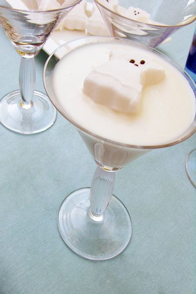 """Ghost Martini... 2 ounces Pinnacle Whipped Vodka. 1 ounce vanilla vodka. 1 ounce Godiva White Chocolate liqueur (you can sub white creme de cacoa if you don't have this) 2 scoops of very melty vanilla ice cream (almost pourable) DIRECTIONS: Put ice in two martini glasses to chill. Put a handful of ice and all of your ingredients  into a cocktail shaker. Shake well. Remove the ice from the glass and pour. Garnish with a ghost """"Peep"""". You can line the rim with black sprinkles."""