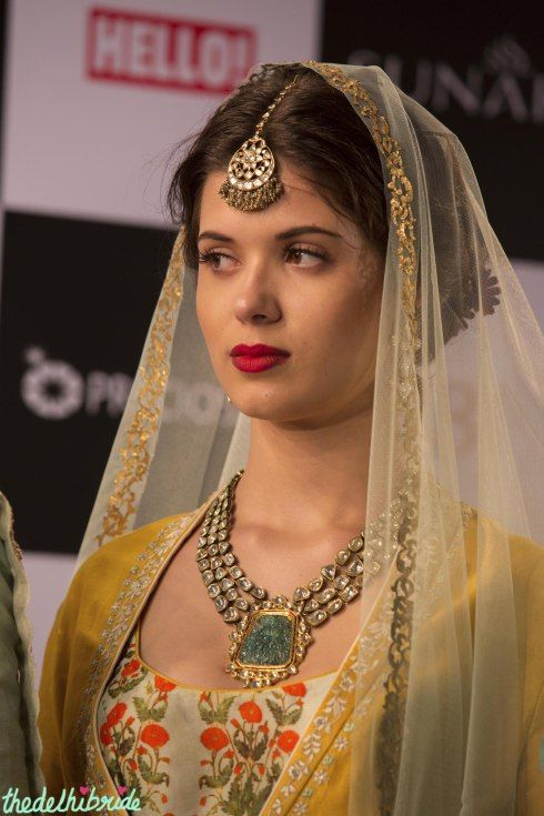Jewellery & makeup - Anju Modi Amazon India Couture Week 2015 Kundan or polki maang tikka and three-string necklace with green stone and bride with bright lips