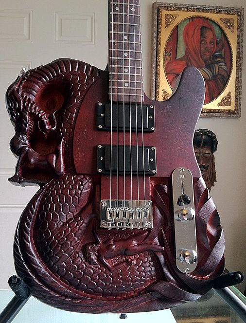 """YorMajesty's 2012 Telecaster (Carved Dragon Slayer) Electric guitar: specifics:  Body: Basswood - String Configuration: 6 Strings - Dexterity: Right - Handed - Color: Brown·- Controls: 1 Volume, 1 Tone and 3-Way Pickup Selector - Neck: Maple - Fretboard: Rosewood · Dot Mother-of-Pearl Fret Inlays · Scale Length ~ 628MM/21F"""" · Chrome Plated: Hardware · Chrome Metal: Tulip Tuners · Chrome: Bridge"""