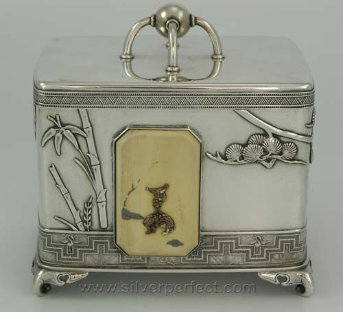 A sterling silver Tiffany Japanese motif tea caddy with removable lid