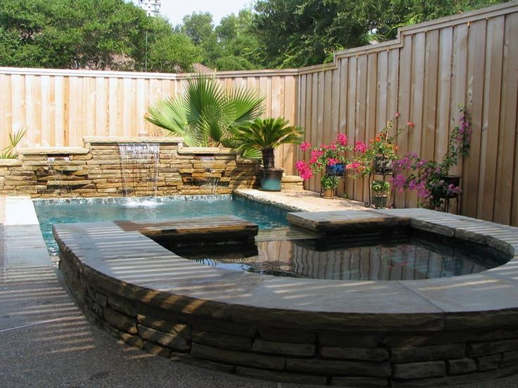 Straight line pool in dallas with raised spa raised back for Pool design 101