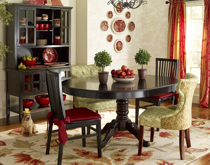 Rescued Puppy Sitting In A Dining Room Featuring The Pier 1 Ronan Pedestal  Extension Table In