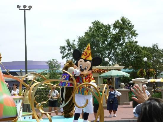 Mickey Mouse on a parade float at the Magic Kingdom